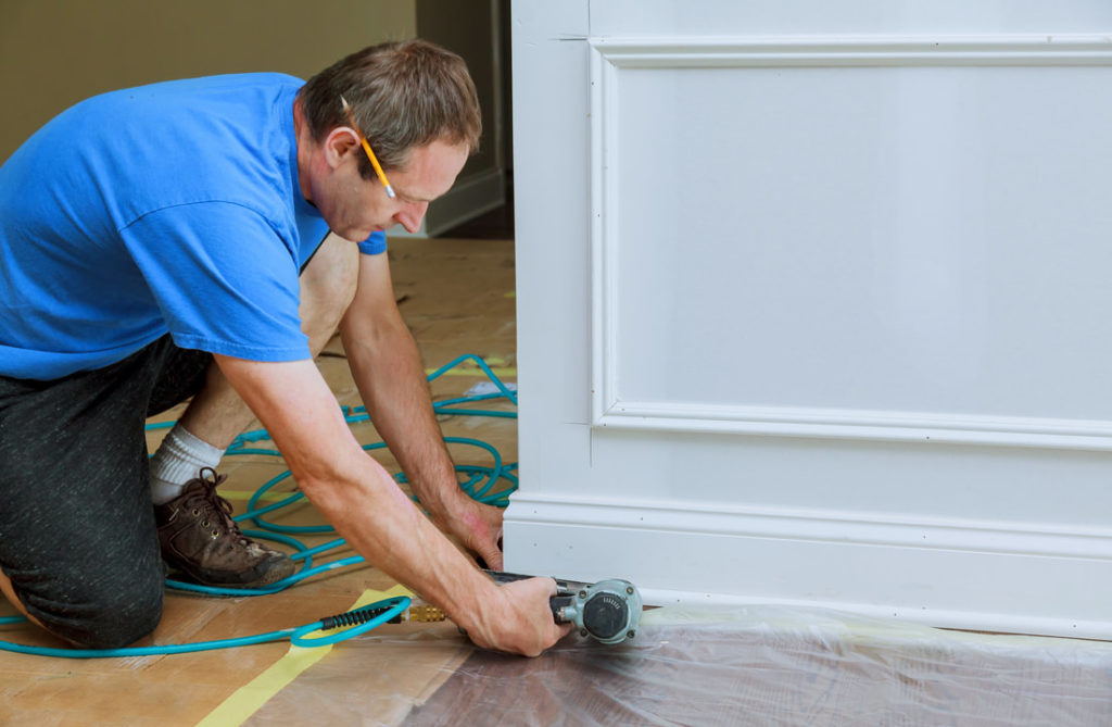 Delaware County Handyman Installing New Trim In A Living Room For A Big Job