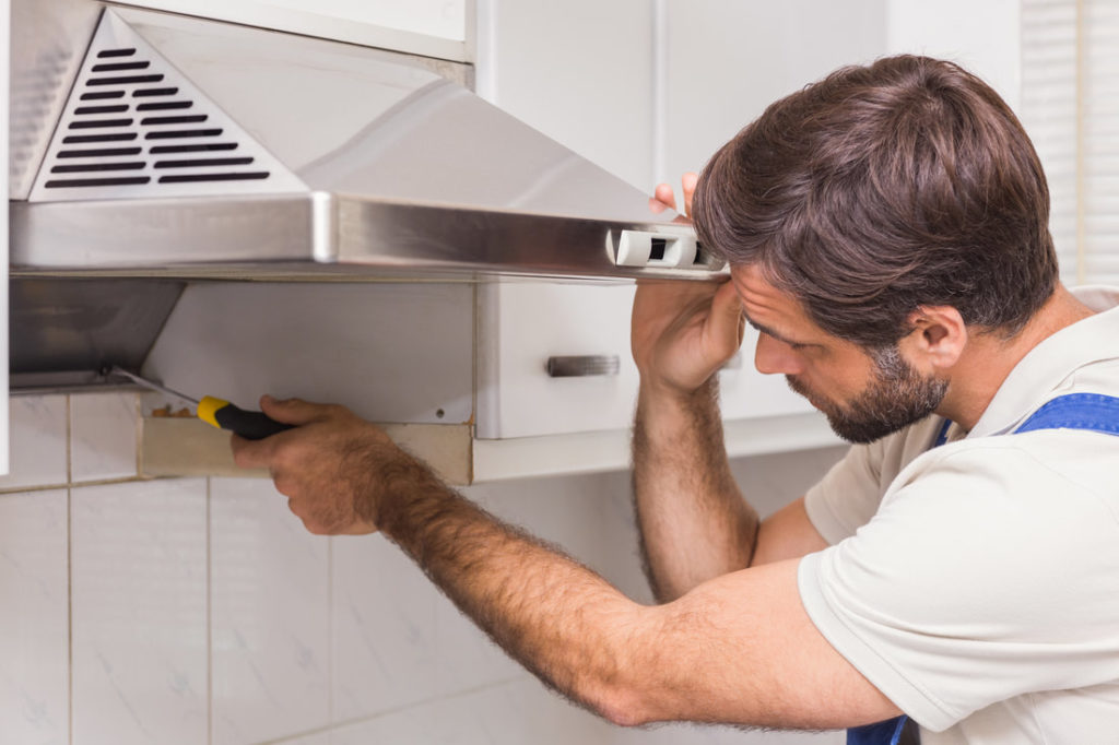 Delaware County Repair Man Fixing And Installing A Vent For An Oven In Delco