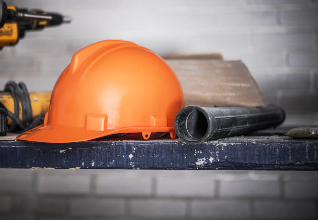 Picture Of A Hard Hat And Vaccuum Hose On A Table PIcture Taken By Delaware County Handyman
