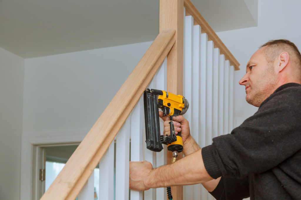 Picture Of A Man Replaceing A Stairway Railing In Delaware County Pa Taken By Delaware County Handyman