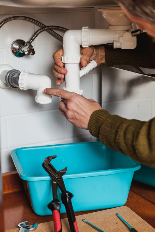 Delaware County Handyman Replacing A Sink Trap That Was Old And Broken